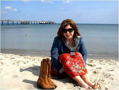 the antiques diva on the beach in germany, cowboy boots,