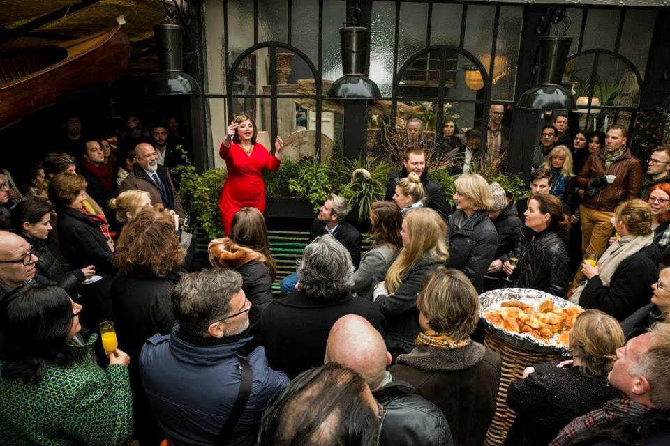 Toma Clark Haines speaks to her guests at The Antiques Diva Paris Flea Market Fête