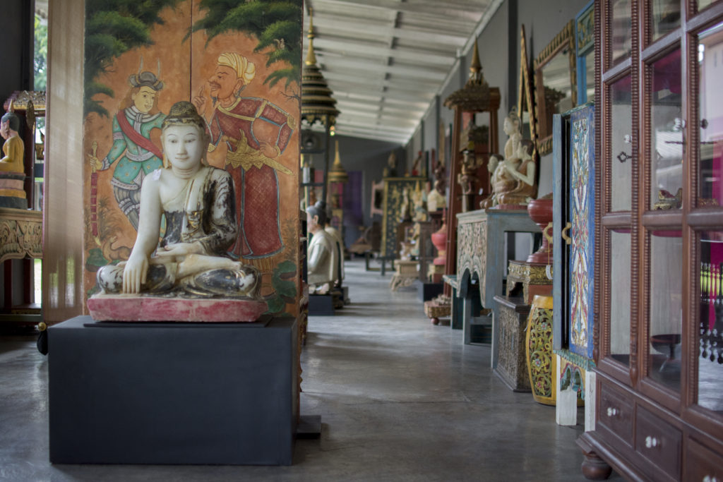 Marble Sitting Buddha Statue in front of Antique Thai Painting Antiques Diva Asia Buying Tours Thailand: Chiang Mai
