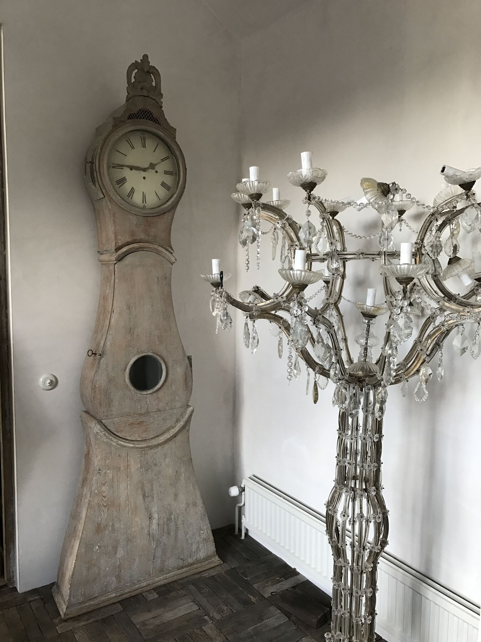 Antique Swedish clock and candelabra Source Antiques Like the Pros- Why Sweden is HOT for Sourcing Antiques | Toma Clark Haines | The Antiques Diva & Co